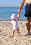 Hold my hand dad to explore the beach Stock Image