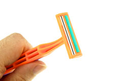Hold orange razor on left isolated Royalty Free Stock Images