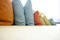 Hold pillow  on the long sofa Royalty Free Stock Image