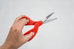Hold a red scissors. Isolated hold a red scissors Royalty Free Stock Photos