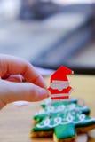 Hold Santa Claus' hand Royalty Free Stock Image