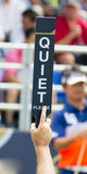 Hold sign Quiet Please in competition golf. Royalty Free Stock Photos