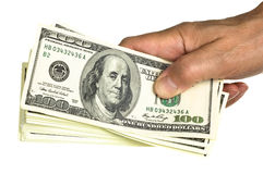 Hold stack 100 dollars in hand Royalty Free Stock Image
