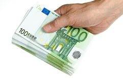 Hold stack of 100 euro in hand. On the white background Royalty Free Stock Images