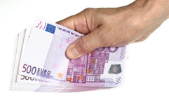 Hold stack of 500 euro in hand. On the white background Royalty Free Stock Images