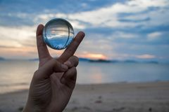 Hold two fingers crystal ball. Stock Photo