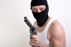 Hold up man. A masked thug with an old west  six-shooter style gun with hammer cocked Royalty Free Stock Photo