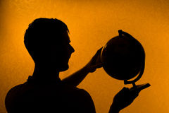 Hold the World - silhouette of man Royalty Free Stock Image