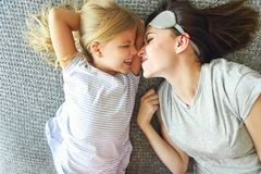 Cute loving emotional woman hugging her daughter tight while spe royalty free stock photos