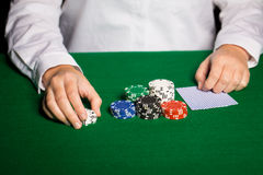 Holdem dealer with playing cards and casino chips Stock Photos