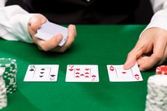 Holdem dealer with playing cards and casino chips Stock Image