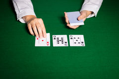 Holdem dealer with playing cards Stock Photo