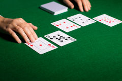 Holdem dealer with playing cards Stock Images