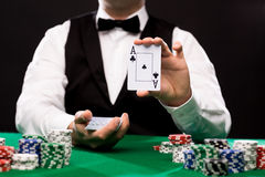 Free Holdem Dealer With Playing Cards And Casino Chips Stock Photos - 48144393