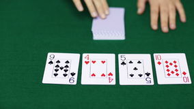 Holdem poker dealer with playing cards stock footage