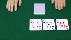 Holdem poker dealer with playing cards stock video