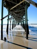 Holden Beach Pier. Pier along shore at Holden Beach, North Carolina stock photography