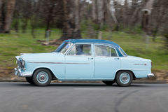 1956 Holden FE Sedan driving on country road Stock Photography