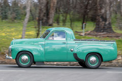 1952 Holden FX Utility driving on country road. Adelaide, Australia - September 25, 2016: Vintage 1952 Holden FX Utility driving on country roads near the town Stock Images