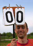 Holder. A man holding a score board on a game of american football Stock Photography