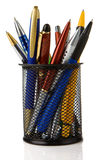 Holder basket full of pens isolated on white Royalty Free Stock Photos