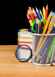 Holder basket and notebooks on black Royalty Free Stock Images