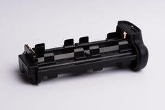Holder for Battery grip. AA Battery Holder for Battery grip for DSLR cameras  on white background Stock Photo