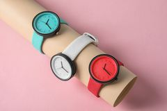 Holder with collection of stylish wrist watches on color background. Fashion accessory royalty free stock image