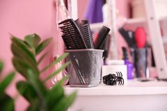 Holder with different combs. At hairdresser`s workplace Royalty Free Stock Image