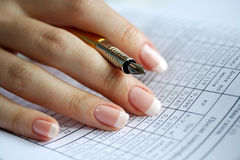 Holder  in a female hand. Table of data, statistics Royalty Free Stock Photo