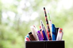 Holder full of pens and pencil Stock Images
