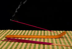 Holder with incense stick. Royalty Free Stock Photos