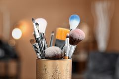 Holder with makeup brushes stock photography