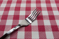 Holder of table. Holder of stainless table on a tablecloth Stock Photography