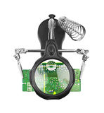 Holder to use in repair circuit board Royalty Free Stock Photo