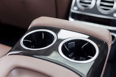 Holders for cups for rear seats in luxury car.  Royalty Free Stock Photography