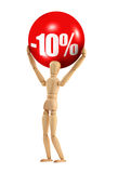 Holding a 10% discount sign. Wooden figure holding a 10% discount sign royalty free stock photography