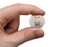 Holding a 10 NT Dollar Coin. A male thumb and index finger gripping a New Taiwan 10 Dollar Coin Royalty Free Stock Image