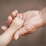 Holding. Baby hand close up Stock Photo