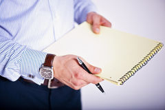 Holding A Paper And A Pen Stock Photography