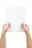 Holding A Sheet Of Paper Royalty Free Stock Images