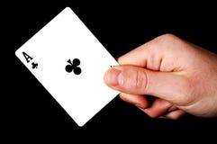 Holding Ace card. Holding Ace on black background Stock Photography