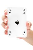 Holding an Ace of Spades Stock Photo