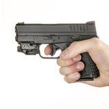 Holding a .45 ACP handgun Stock Photos