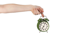 Holding alarm clock Stock Photo