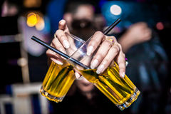 Holding 2 alcohol glasses Royalty Free Stock Photography