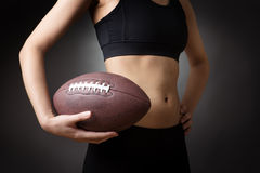 Holding american football Royalty Free Stock Images
