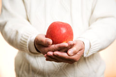 Free Holding An Apple Stock Photo - 5116220
