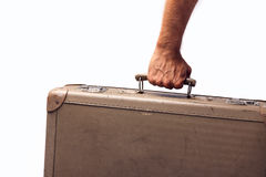 Holding antique suitcase. Travelling with antique suitcase, white backgorund concept Royalty Free Stock Images