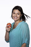 Holding an apple. stock images